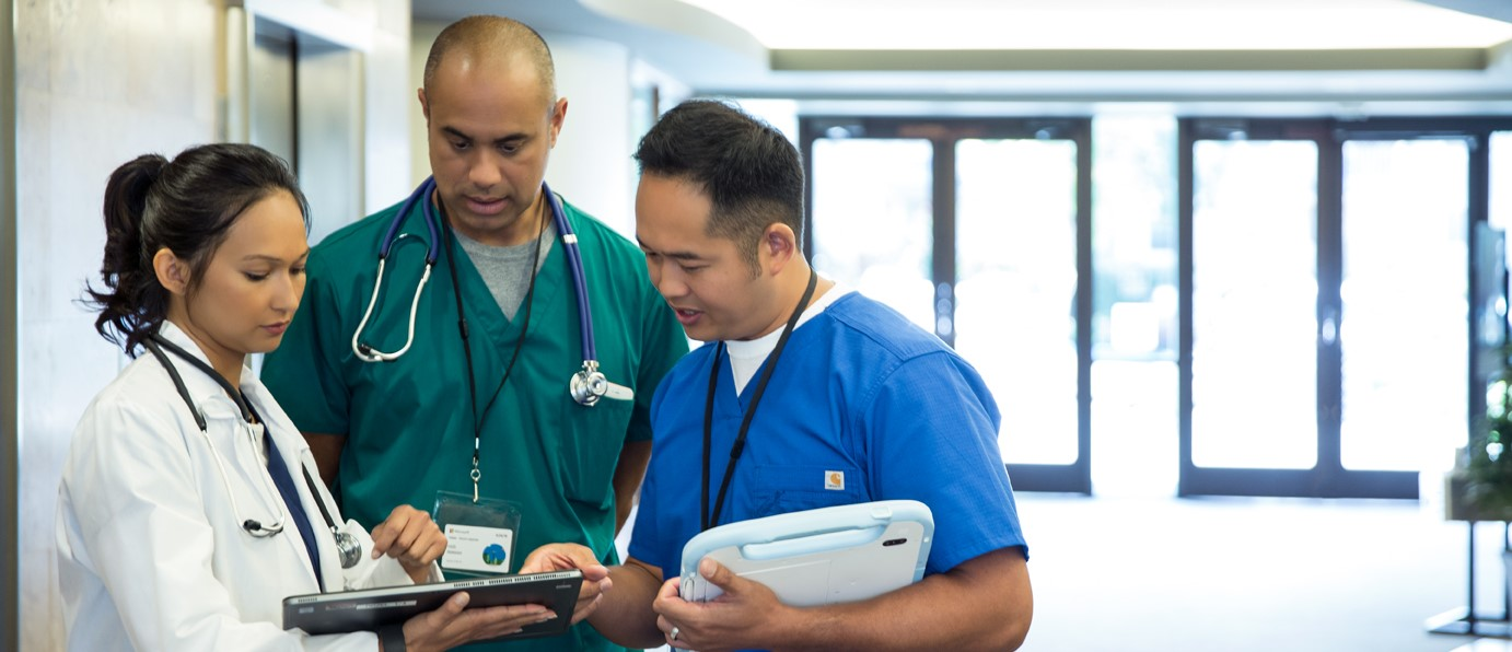 Healthcare professionals looking at laptop